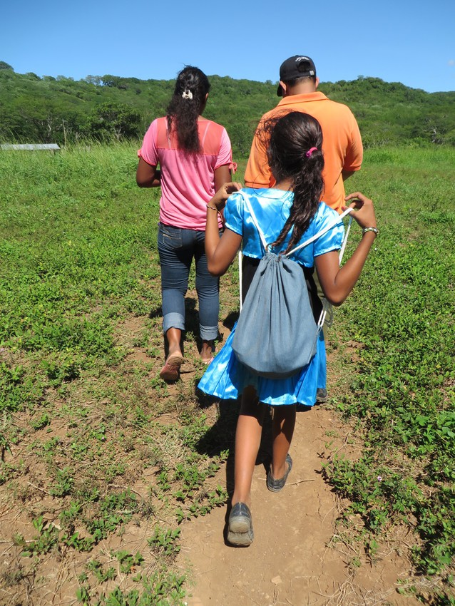 A Nicaraguan girl carries her LWR School Kit. Without these kits, many children in the rural area of Mateare Caranzo couldn't attend school because they don't have supplies.