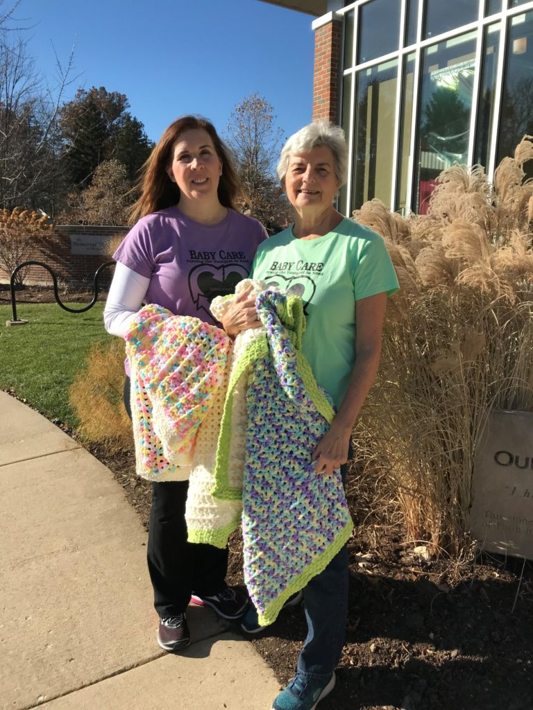 Jennifer Schuler (left) and Betty Landorf are co-leaders of Baby Care. [Photo: Jennifer Schuler]