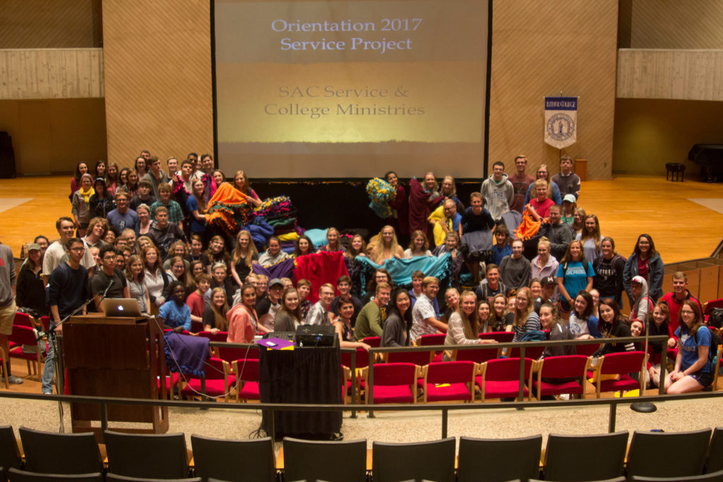 Students at Luther College pose with the Fleece Tie Blankets they assembled for LWR as part of orientation [Photo: Annie Goodroad].