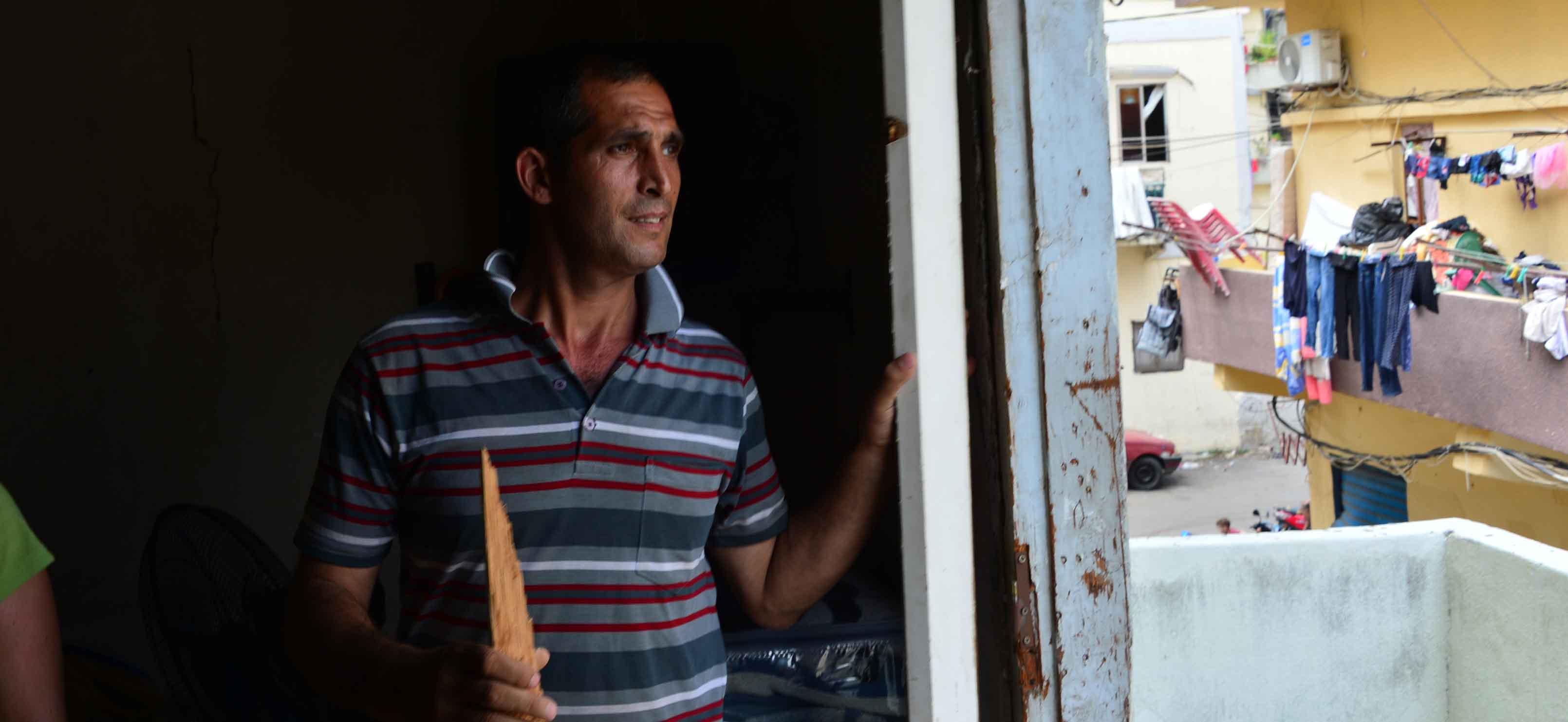 Khayrallah Warde, 40, was on his way home from Tripoli when he heard about the blast. His three children were at home in Beirut, Lebanon in the family's two-room flat and told him the doors blew in off their hinges. Thankfully, they are safe. Unemployed, Khayrallah says he cannot afford to fix the doors to his family's home.