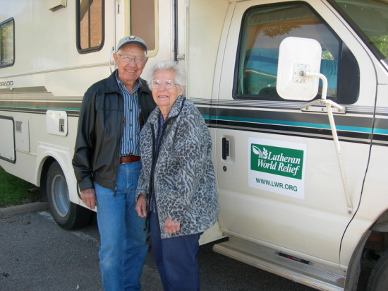 Ken and Muriel standing in front of their RV