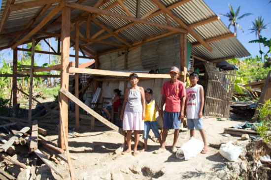 family standing outside new shelter