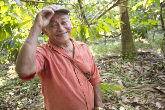 "Cocoa farmer Mario Isabel Taicigue on his farm near Rio San Juan. He first started growing cocoa in 2007. ""It has been a big help for our income,"" he says."