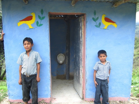 two boys stand in front of new ecological bathroom