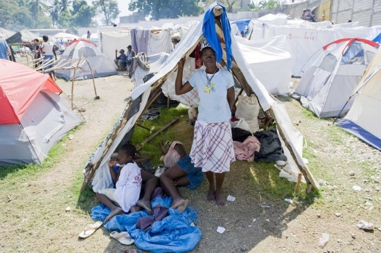 A woman and her family live in a tent community on a soccer field in Jacmel, Haiti.