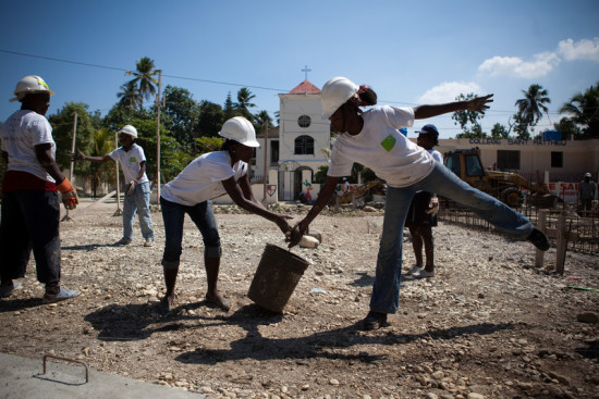 workers in Leongane, Haiti, pass a bucket down a line