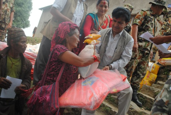 Staff from LWR and local partner, COPPADES, distribute relief supplies in Ghorka District, after the 2015 Nepal Earthquake. (Photo Credit: COPPADES for LWR)