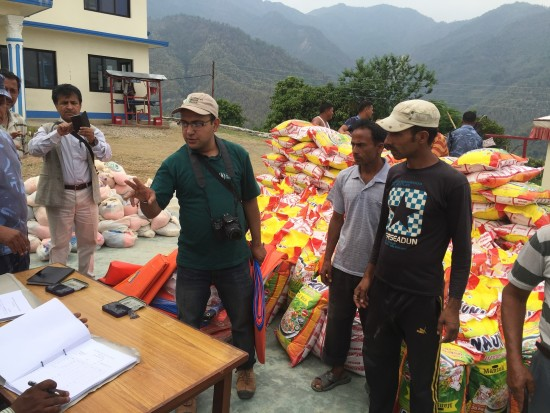 LWR and partners work to coordinate a food distribution to people in the remote village of Jaubari – Dhansar.