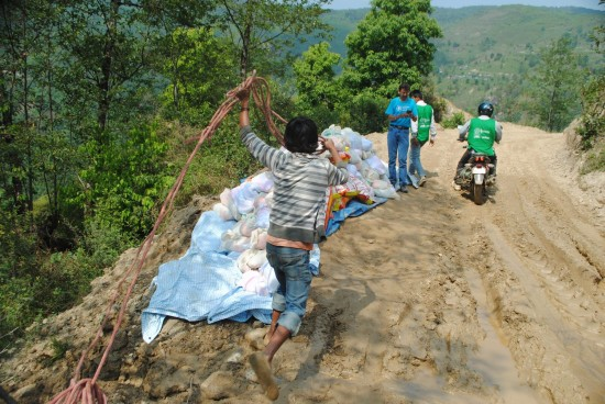 LWR staff and staff from local partner organization, COPPADES, distribute relief supplies in Ghorka District, after the 2015 Nepal Earthquake. (Photo credit: COPPADES for LWR)