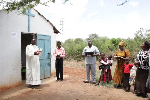 Pastor Bernard Kyambo and the members of the Makindu Lutheran Mission.