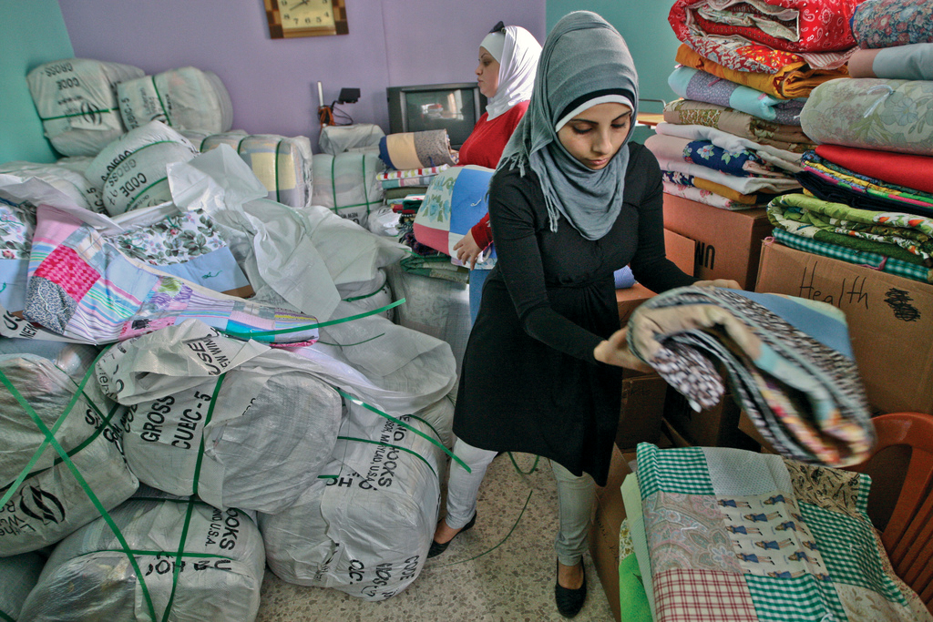 ANERA shipped 24,000 quilts, donated by Lutheran World Relief, to Palestinian refugees from Syria in camps across Lebanon. (Credit: Charlotte Bruneau/ANERA)