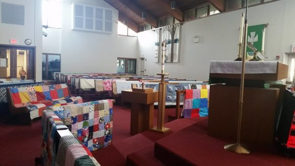 View from altar of quilts over pews