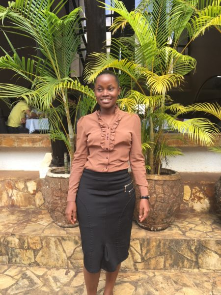 Dina Mwilanga stands proudly. She is one of many young people discovering an agricultural career thanks to your support of Lutheran World Relief.
