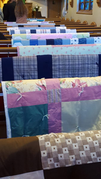 Quilts on the pews of First Lutheran Church