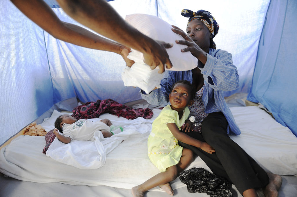 Marie Sylsalve received a Baby Care Kit for baby McAnley who was born 12 days after the earthquake struck Haiti