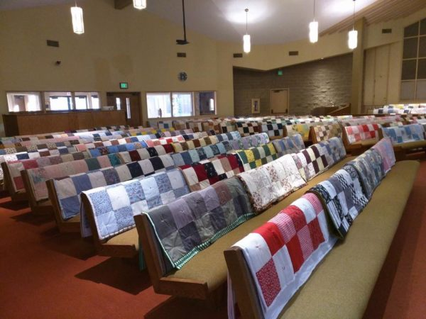 Side view of quilts over pews