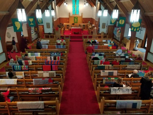 Overhead view of quilts on pews