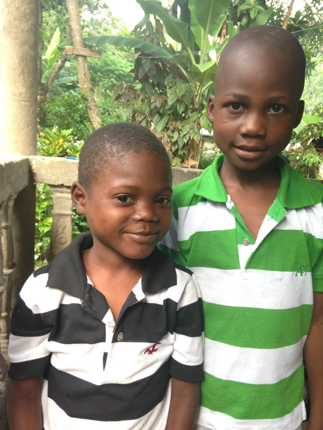 The son of coffee farmer Lindor Wisly (right) stands with another child from the community of Dondon, Haiti. Although the boy on the left is three years older, lack of food may have contributed to his smaller size.