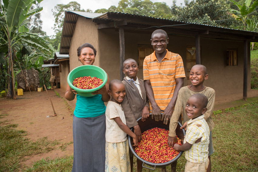 The Wotea family stands in front of their house in Bududa District, Uganda.