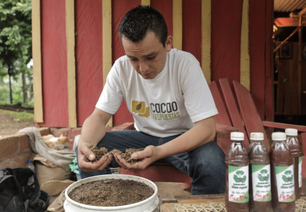 Cesar Lopez works with the fertilizer he produces using the skills he learned in the Cocoa diploma project.