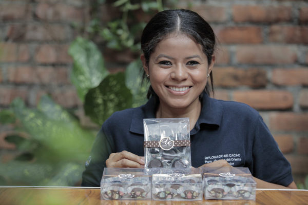 Beatriz Villatoro holding chocolate bon-bons she produces in El Salvador, which she was inspired to make after completing the Cocoa diploma project.