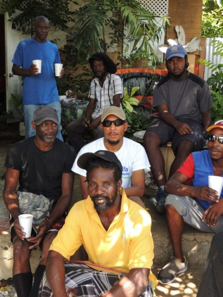 Staff from LWR partner Habitat for Humanity with a group of construction workers helping to rebuild in Dominica.