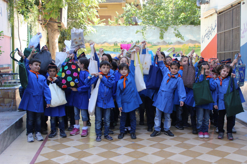 School children in Damascus, Syria show off their new School Kits