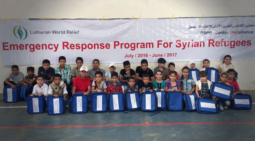 boys and girls holding School Kits