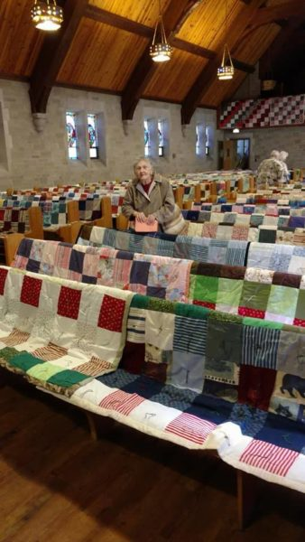 View from front of sanctuary of quilts on pews