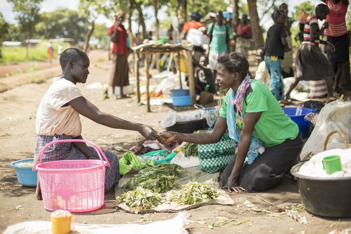 Akwanga Paulina (30, r) sells vegetables in the market that she cultivated with seeds and training from Lutheran World Relief in Palabek Refugee Settlement in northern Uganda.