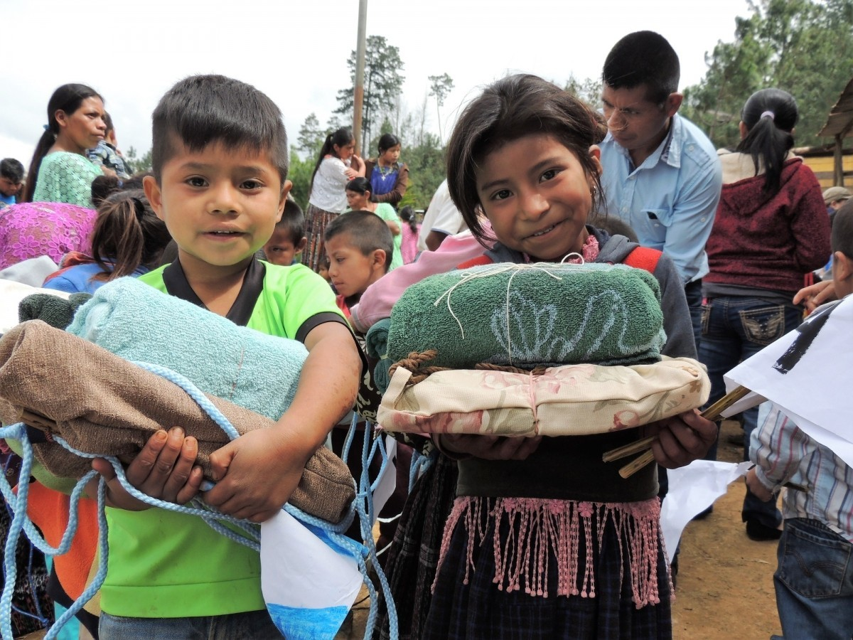 Students receive school and hygiene kits at Kaqlahib primary school in San Juan Chamelco, Coban, Guatemala.