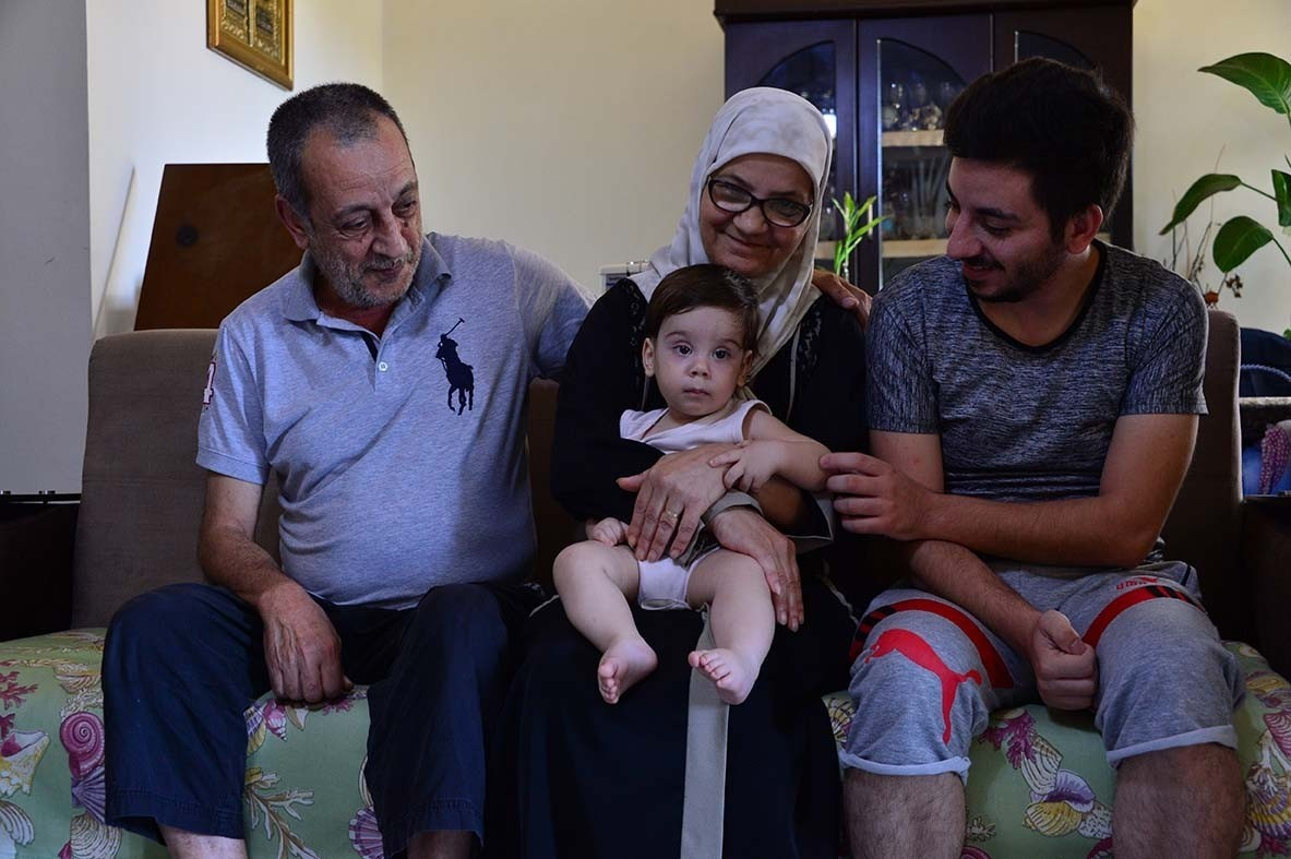 The Hammal family, out in Beirut's southern suburbs, exemplify the collapse of Lebanon's middle class. Mohammad Hammal (right) left his job at Beirut's port just a couple of hours before the Aug. 4 explosion. He sat with his mother and father, and his infant son, Rafic, watching the tragedy unfold. He had already been cut back to half time as an employee, putting a strain on the family's finances. The next day he found out his job was gone. Mohammad is the family's breadwinner in their middle class home.