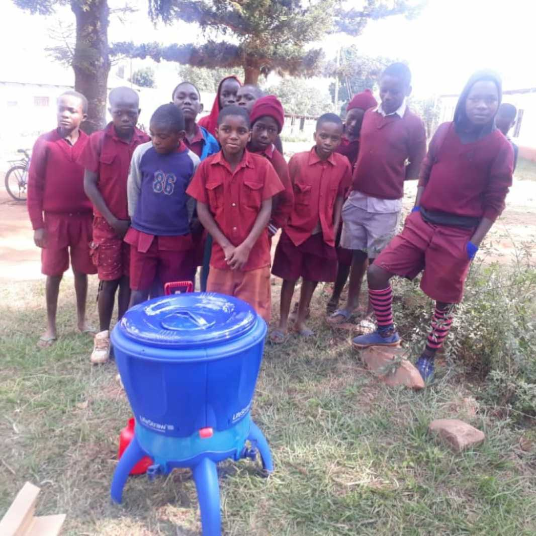Students pose with their new water filters, provided by you, following Cyclone Idai. Along with the water filters, our local partners are teaching students and school staff improved hygiene and sanitation practices. (Photo courtesy of Smile for Africa)