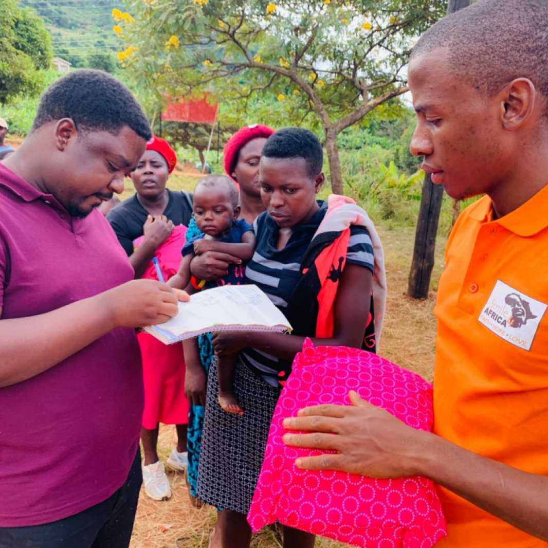 Staff from Smile for Africa distribute items to families, many of whose homes were destroyed in Cyclone Idai. (Photo courtesy of Smile for Africa)