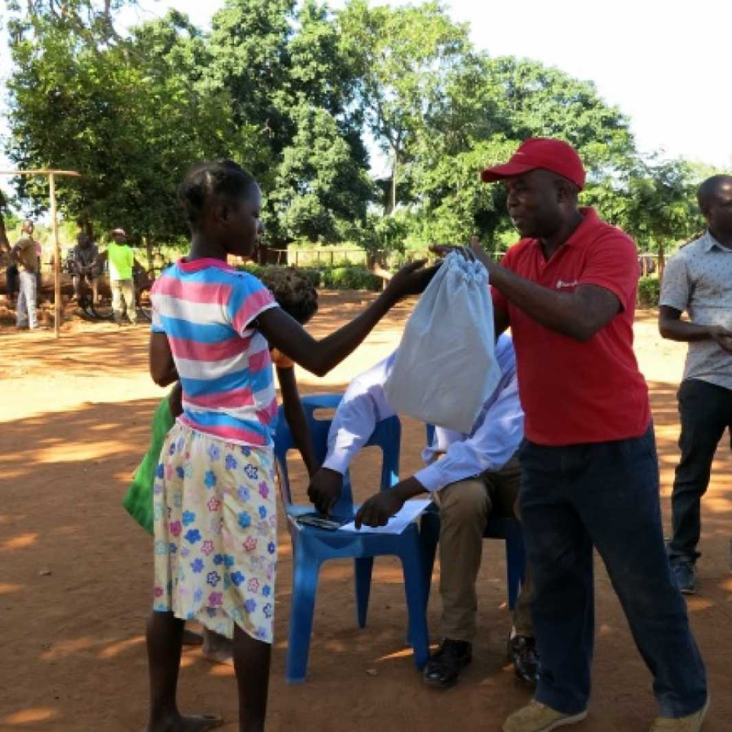 Local staff in Mozambique distribute LWR School Kits to survivors of Cyclone Idai. (Photo courtesy of Save the Children)
